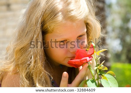 The young beautiful girl the blonde with a scarlet rose - stock photo