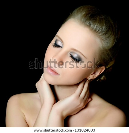 The young beautiful girl with Evening make-up - stock photo