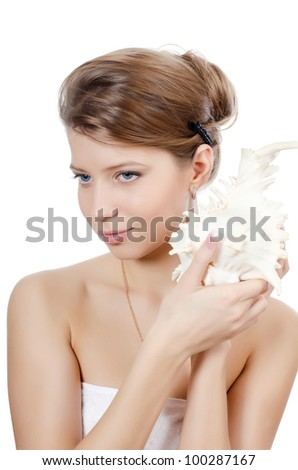 The young beautiful girl with seashell isolated - stock photo
