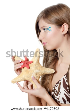 The young beautiful girl with starfish isolated - stock photo