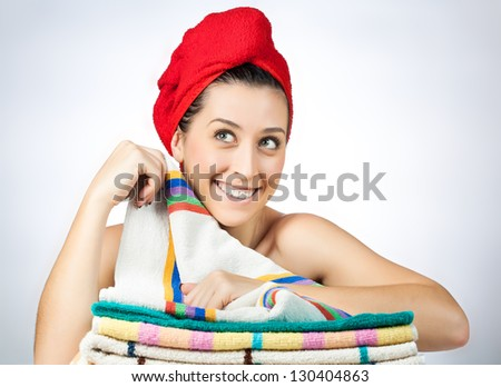 The young beautiful girl with towel on hair - stock photo