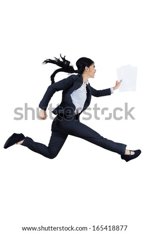 The young beautiful woman runs by holding business paper - stock photo