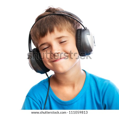 The young boy is enjoy the music - stock photo