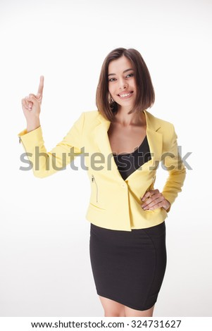 The young business woman showing something on the white background - stock photo
