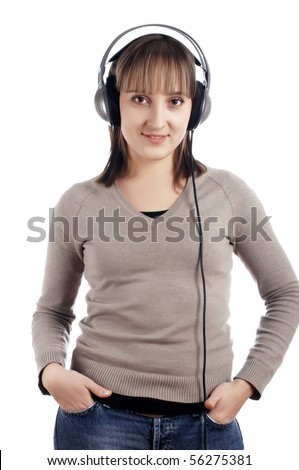 The young charming smiling girl listens to music in ear-phones - stock photo