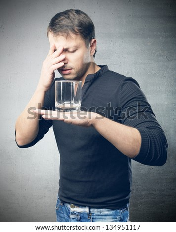 The young depression man with glass in hand - stock photo
