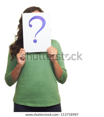 The young girl in green shirt holding a sheet of paper with a big question mark, covering her face. Isolated on white background - stock photo