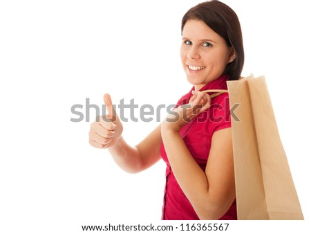 The young girl is carrying a shopping bag - stock photo