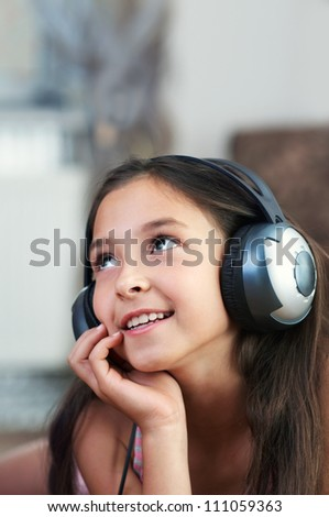The young girl is listening to music - stock photo