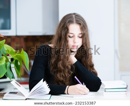 The young girl is studying - stock photo