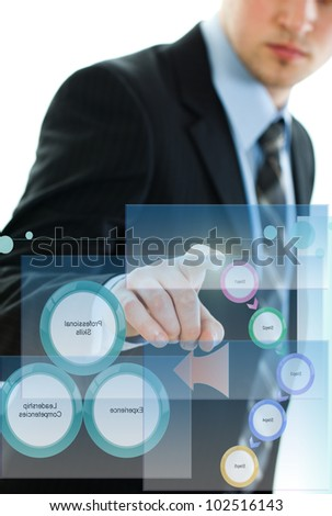 The young guy is working with business diagramams - stock photo