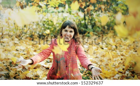 The young happy woman in autumn park - stock photo