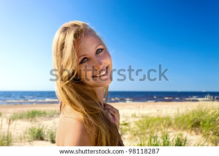 The young happy woman on a beach. - stock photo