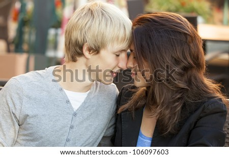 The young man and girl in the cafe - stock photo
