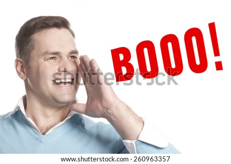 The young man announces declares: Booo - stock photo