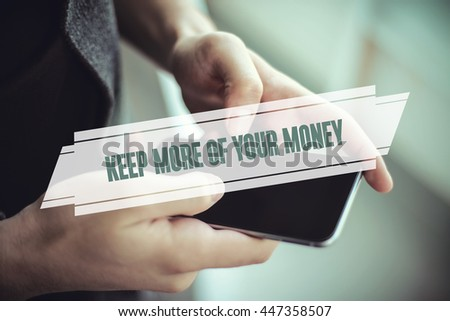 The young man holds the hand Keep More Of Your Money by smartphone - stock photo