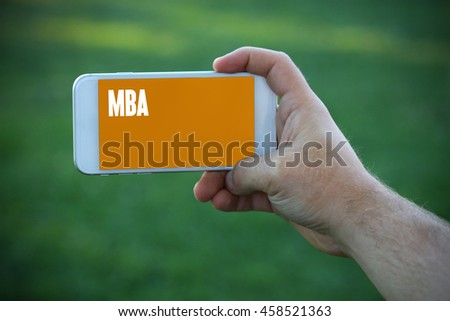 The young man holds the hand Mba by smartphone - stock photo