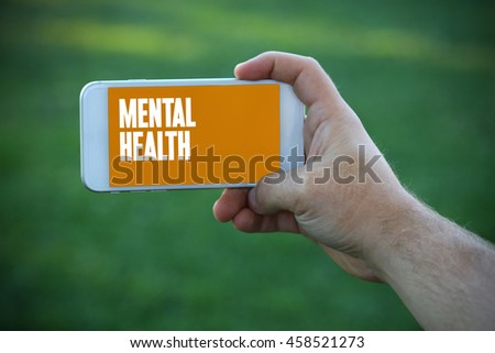 The young man holds the hand Mental Health by smartphone - stock photo