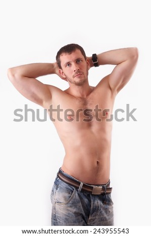The young man in the studio shirtless - stock photo