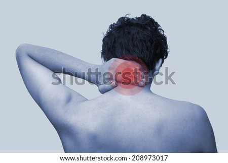 The young man keeps for neck. On a blue background - stock photo
