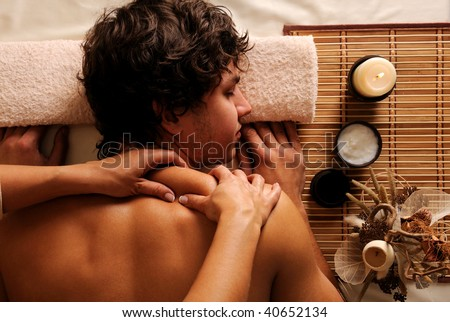 The young Man on spa treatment - recreation,  rest,  relaxation and massage. High angle view - stock photo