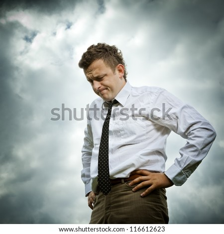 The young man responds to bad news. He Is worried and absent thoughts. - stock photo