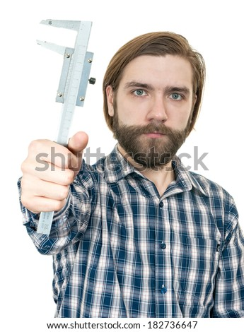 the young man with beard a holding caliper in hand - stock photo