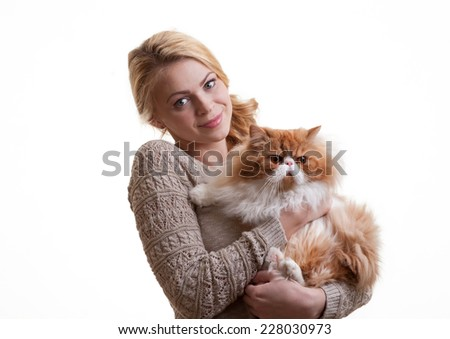 The young nice girl holds a red Persian cat on hands - stock photo