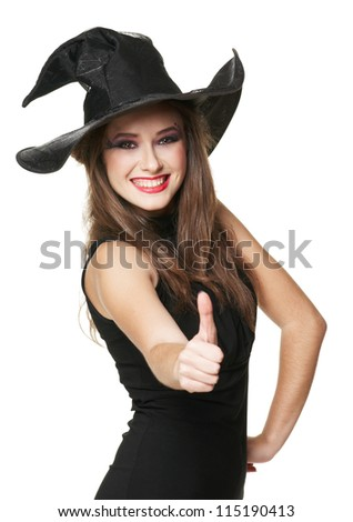 The  young smiling witch is thumb up - stock photo