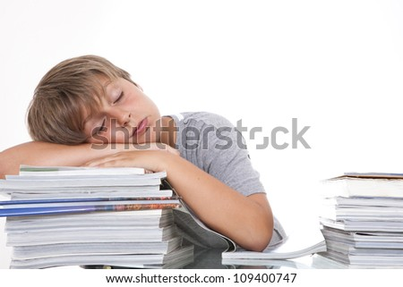 The young student sleeps on the books. Studio shot. - stock photo