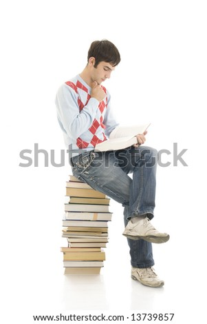 The young student with the books isolated on a white background - stock photo
