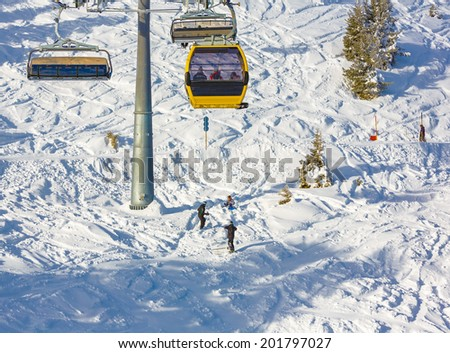The young tourists on a mountain-skiing slope of the resort of Mayrhofen - Austria (black and white) - stock photo
