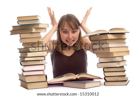 The young woman and a pile of books - stock photo