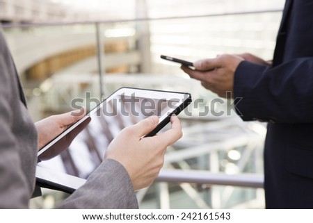 The young woman operating an electronic tablet - stock photo