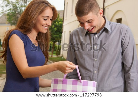 The young woman shows what she bought - stock photo