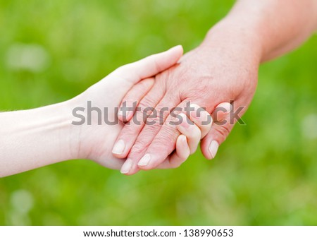 The young woman support the elderly woman - stock photo