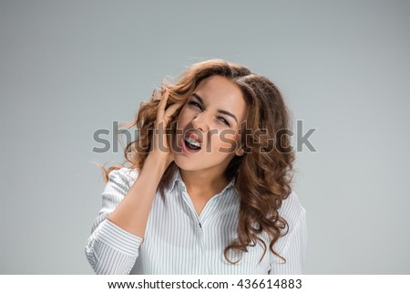 The young woman with earache over gray - stock photo