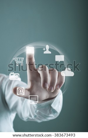The young women pressing virtual icons  - stock photo