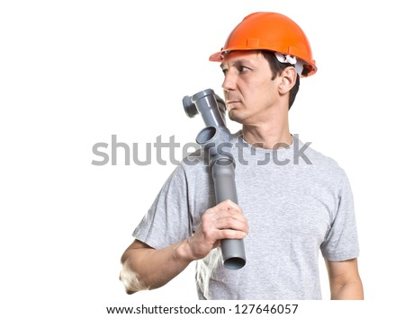 the young working plumber with the tool - stock photo