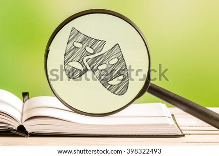 Theater information with a pencil drawing of a drama icon in a magnifying glass - stock photo