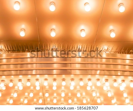 Theater marquee lights walkway to the theater. Aligned theater lights of Chicago Theatre - stock photo