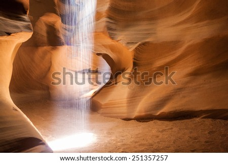 Theater of Light Performing in One of The Caves of the Unique Antelope Canyon in Arizona State, United States of America. Horizontal Image - stock photo