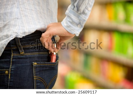 Theft of a young woman in a supermarket - stock photo