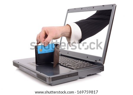 Theft over the internet concept with a hand popping out of the screen to steal a credit card, isolated on a white background - stock photo