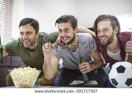 Their favourite team is about to win the championship - stock photo