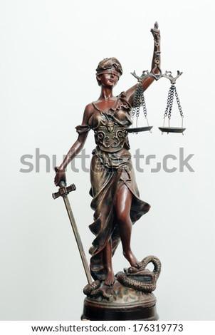 themis, femida or justice goddess sculpture on white - stock photo