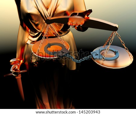 Themis statue and handcuffs   - stock photo