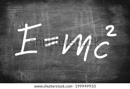 Theory of relativity by Albert Einsteins on school board  - stock photo