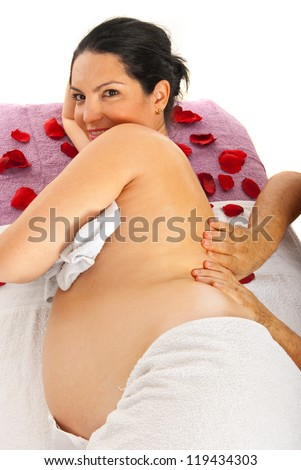 Therapist man massaging back to pregnant woman on table against white background - stock photo