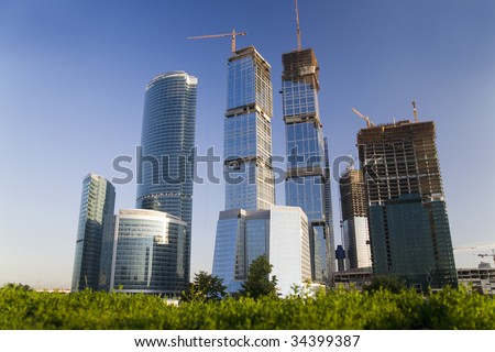 There are not finished modern futuristic skyscrapers. - stock photo